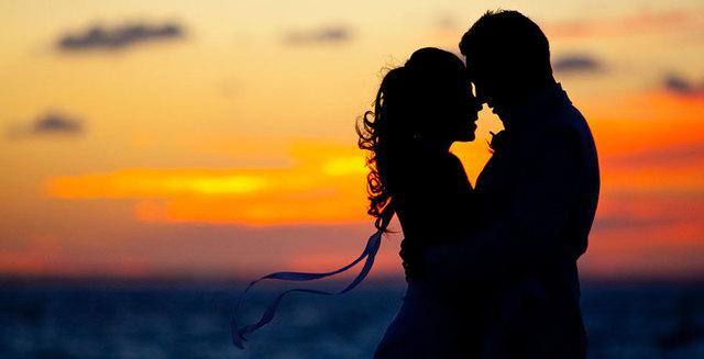 1430969116 couple sunset silhouette caribbean beach wedding