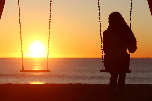 1431424043 bigstock single woman alone swinging on 84228041