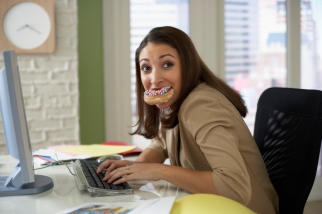 1433409859 woman eating a donut at her computer 78715216 credit fuse 630x420