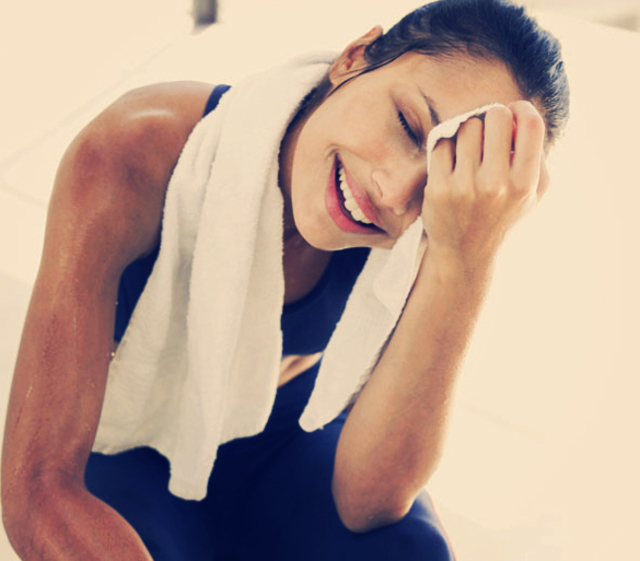1428596699 fitness woman using towel