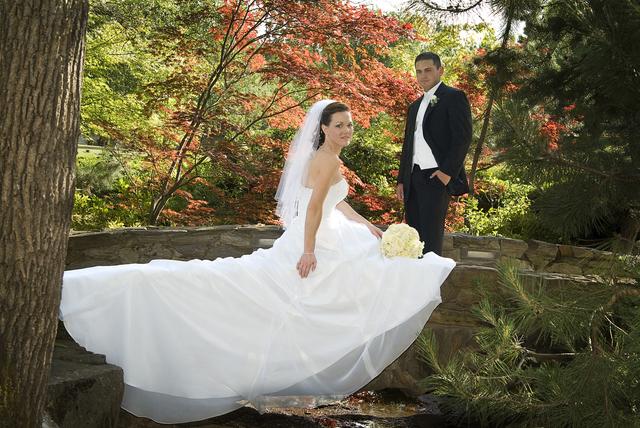 1433844708 bride and groom on bridge