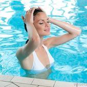 Icon 1434083283 woman in white bikini in swimming pool